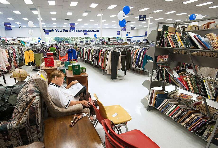 Ed Tilman relaxes with a book during the grand opening of the Goodwill store in Harrison- burg, Va., last month. Shoppers' data may have been breached. Photo: Michael Reilly, Associated Press