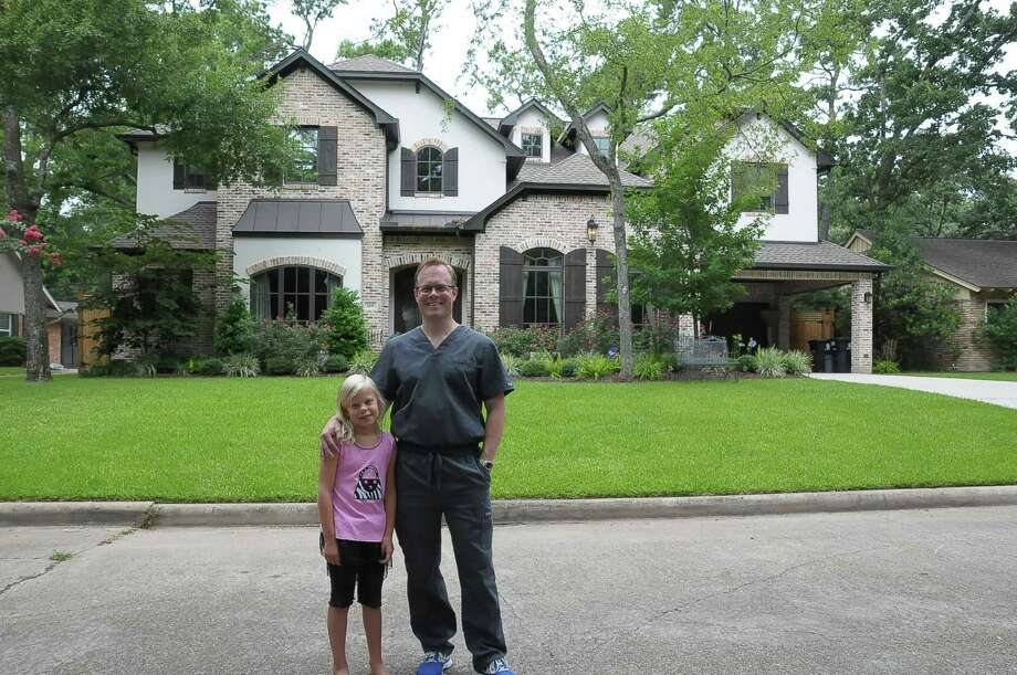 Dr. Brad Jennings and daughter Kaitlin, 8, bought their home at 119 Cinnamon Oak Lane in April. Brad Jennings and his wife, Kristin, spent more than 18 months looking for a house in the Memorial area. Photo: Copyright Tony Bullard 2014, Freelance Photographer / Copyright 2014 Tony Bullard & the Houston Chronicle