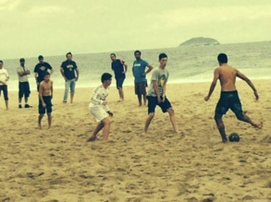 Nick Abbott takes part in a pick-up game on Ipanema Beach in Rio de Janeiro. Photo: Contributed Photo / Greenwich Time