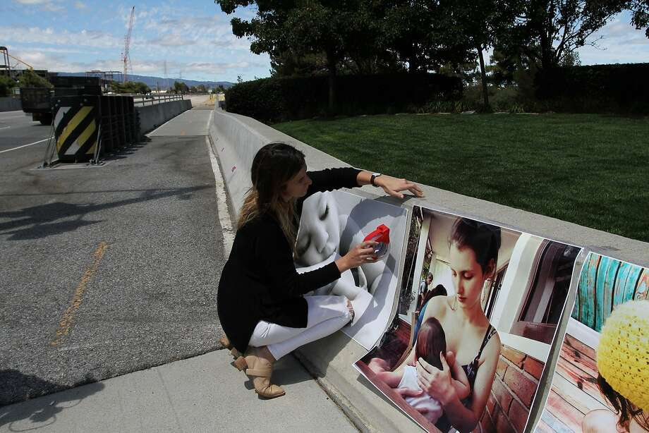 Protester Brittany Tackett puts up some of the photographs that Instagram has removed from its online site. Photo: James Tensuan, The Chronicle