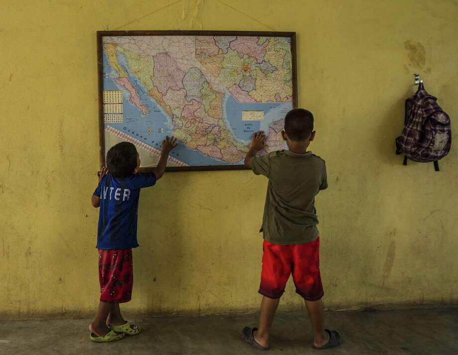 Undocumented immigrant children look at a map of Mexico at  La 72 shelter in Tenosique, Mexico. Our readers comment on the problems with the U.S. response to the crisis. Photo: Meridith Kohut / New York Times / NYTNS