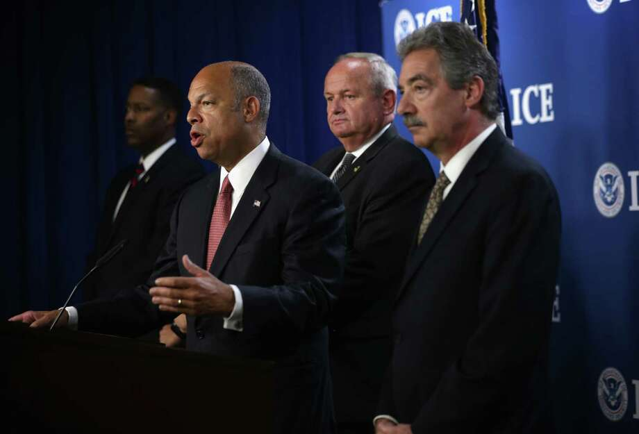 WASHINGTON, DC - JULY 22:  U.S. Homeland Security Secretary Jeh Johnson (2nd L), Immigration and Customs Enforcement (ICE) Principal Deputy Assistant Secretary Thomas Winkowski (3rd L), and Deputy Attorney General James Cole (R) participate in a news conference on human smuggling along the southwest border July 22, 2014 in Washington, DC. Secretary Johnson spoke on Operation Coyote, a 90-day surge operation which is currently conducted in the Texas Rio Grande Valley to target human smuggling operations. Photo: Alex Wong, Getty Images / 2014 Getty Images