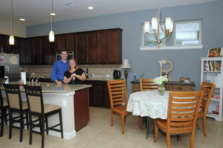 Andy and Jessica Restivo are proud of their new home in Bridgeland. Andy Restivo says prospective homebuyers need to be prepared to move quickly and to spend over the list price of a home. Photo: Copyright Tony Bullard 2014, Freelance Photographer / Copyright 2014 Tony Bullard & the Houston Chronicle