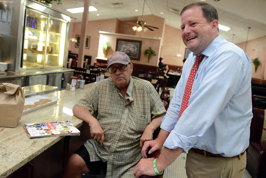 Republican gubernatorial candidate John McKinney talks with Shelton resident Frank Perillo Tuesday, July 22, 2014, at the Plaza Diner in Shelton, Conn. Photo: Autumn Driscoll / Connecticut Post