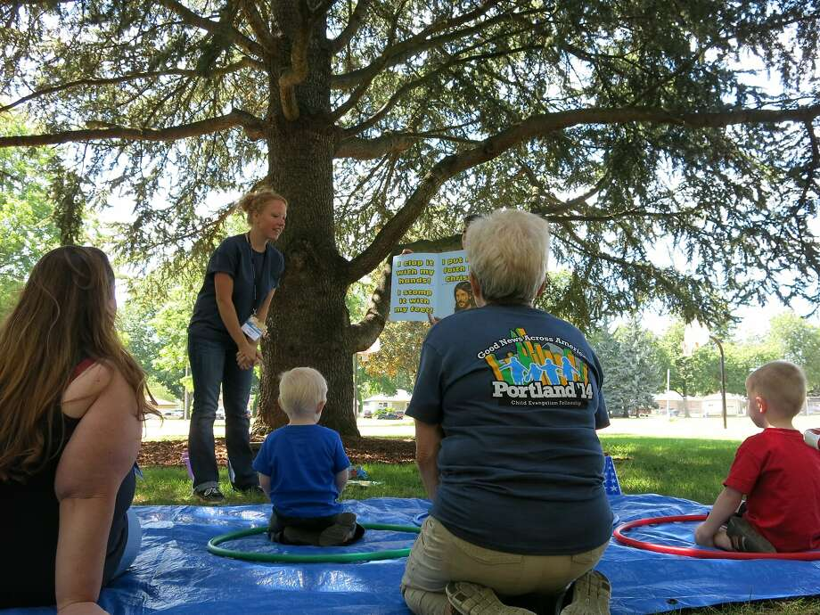 The Child Evangelism Fellowship's Good News Club interacts with kids in a park Monday in Portland, Ore. Polls have consistently indicated that Oregon is among the least religious states in the country. Photo: Nigel Duara, Associated Press