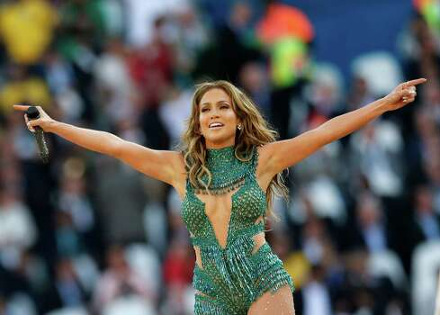 FILE - In this June 12, 2014 file photo, pop singer singer Jennifer Lopez performs at the 2014 World Cup opening ceremony in the Itaquerao Stadium in Sao Paulo, Brazil. A group of of scientists named a water mite in Lopez's honor after discovering a new species near Puerto Rico. The music of the Bronx, New York-born entertainer who has Puerto Rican roots was a hit with the group while they wrote about their findings, biologist Vladimir Pesic said in an email Wednesday, July 16, 2014. (AP Photo/Frank Augstein) Photo: Frank Augstein, Associated Press / AP