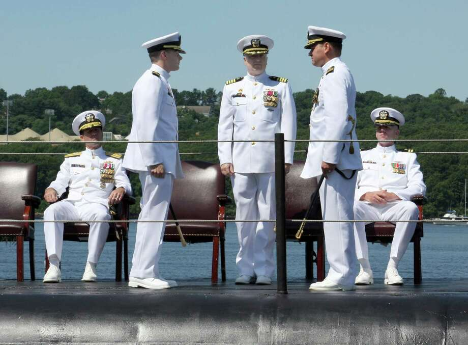 Commander Daniel James Lombardo, second from left, takes command of the USS Springfield at a July 18 ceremony in Groton. Photo: Contributed Photo / The News-Times Contributed