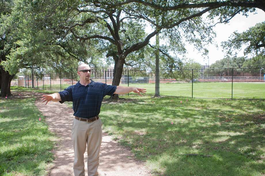 Upper Kirby District Deputy Director Travis Younkin indicates where a pavilion is planned as part of renovations at Levy Park. Other spaces can be used for a farmers market and craft fairs. Photo: R. Clayton McKee, Freelance / ©2014 R. Clayton McKee