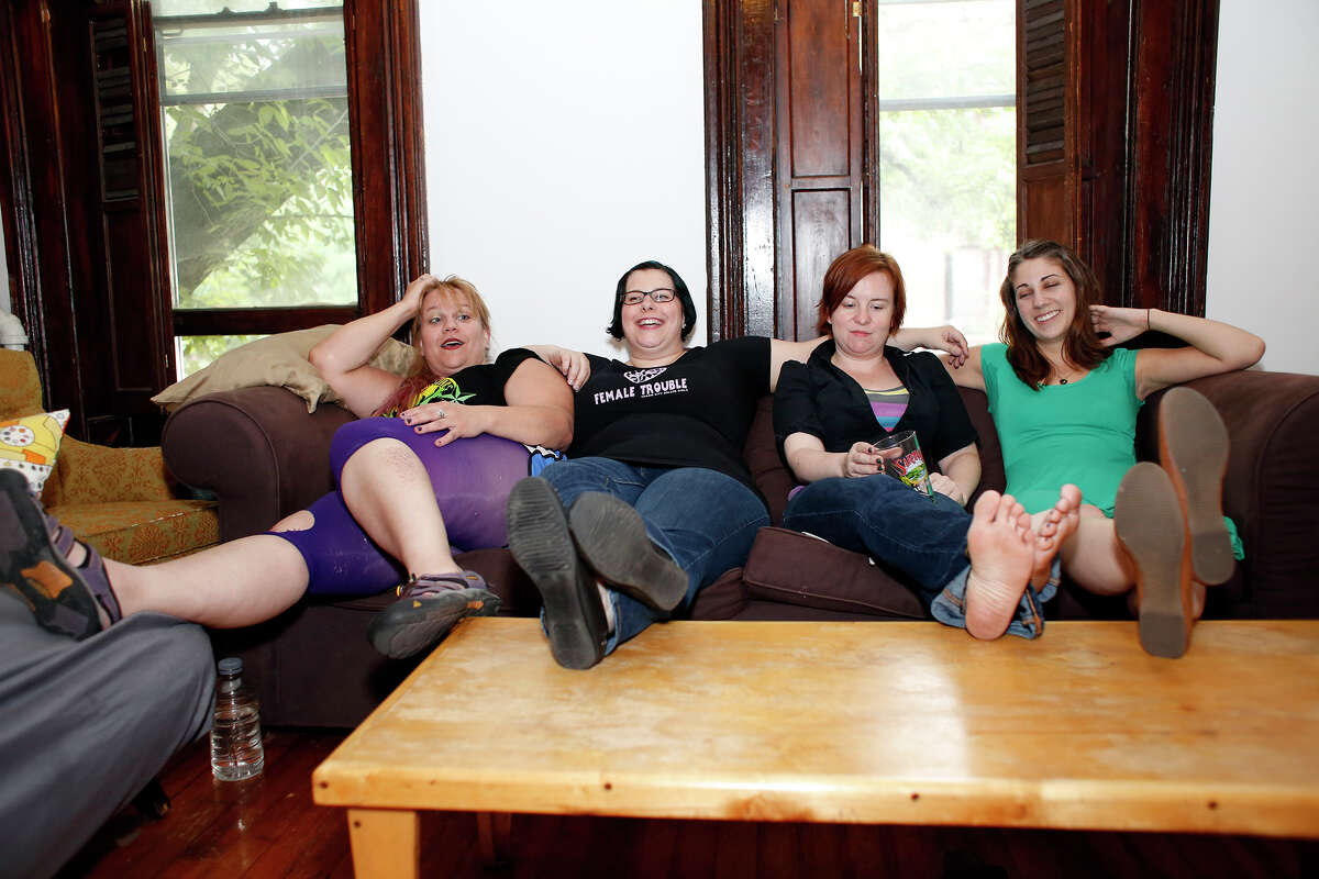 From left to right: Kira Mcginty, Amelia Koethen, Eileen Barlow, and Susie Bafico, sit on the couch as they talk about the negatives of running, on Thursday, July 17, 2014 in Albany, N.Y. (Tom Brenner/ Special to the Times Union)