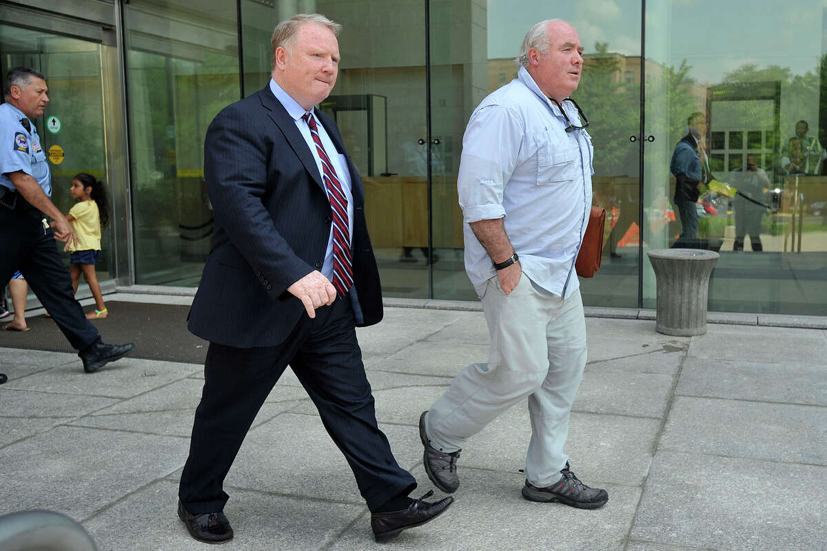 Michael Skakel, right, with his attorney Stephan Seeger, leaves Stamford Superior Court in Stamford, Conn., on Tuesday, July 22, 2014. Seeger said, âÄúWe filed some motions, a motion to suppress and a motion for the return of seized property.âÄù