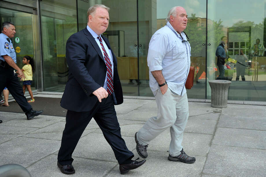 Michael Skakel, right, with his attorney Stephan Seeger, leaves Stamford Superior Court in Stamford, Conn., on Tuesday, July 22, 2014. Seeger said, âÄúWe filed some motions, a motion to suppress and a motion for the return of seized property.âÄù Photo: Jason Rearick / Stamford Advocate