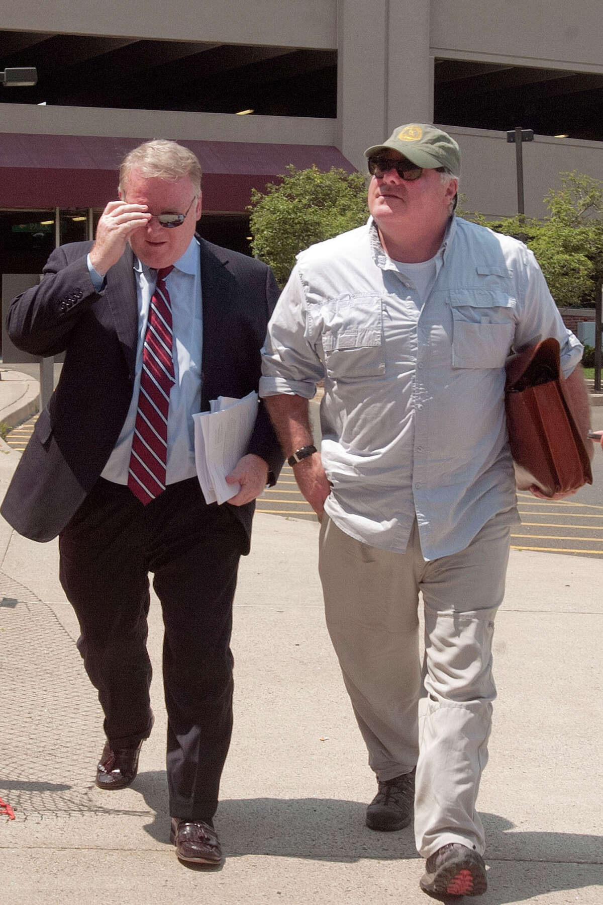 Michael Skakel, right, with his attorney Stephan Seeger, arrives at the Stamford Superior Court in Stamford, Conn., on Tuesday, July 22, 2014. Seeger said, âÄúWe filed some motions, a motion to suppress and a motion for the return of seized property.âÄù