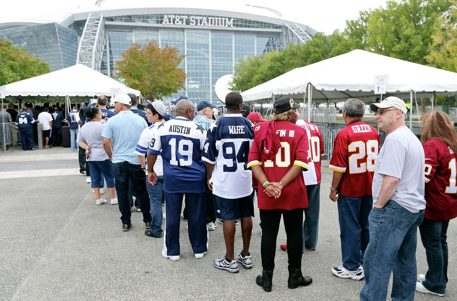 Football fans line up to enter AT&T Stadium before the Dallas Cowboys and Washington Redskins game Sunday Oct. 13, 2013 at AT&T Stadium in Arlington, Texas. AT&T Stadium will once again host the state high school football championships this December. Photo: Edward A. Ornelas, Staff / © 2012 San Antonio Express-News