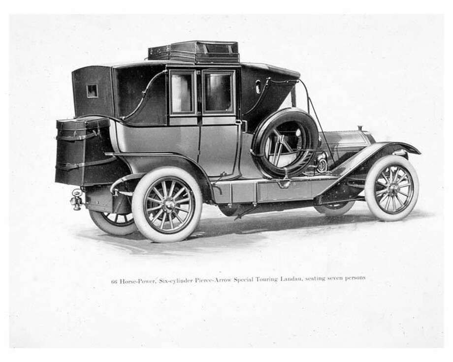 1910:Car maker Pierce-Arrow unveils the Touring Landau at Madison Square Garden in New York. The vehicle, widely considered by historians as the first motor home, features a backseat that unfolds into a bed, a sink behind the chauffeur and, remarkably, a chamber pot. Photo: Pierce-Arrow Factory Photo