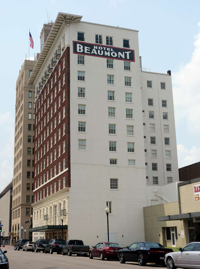 The Hotel Beaumont stands at the corner of Orleans and Fannin streets on Tuesday afternoon. The Beaumont City Council decided Tuesday to postpone the selling of the Hotel Beaumont another week to address concerns by some council members. Photo taken Tuesday 7/22/14 Jake Daniels/@JakeD_in_SETX Photo: Jake Daniels / ©2014 The Beaumont Enterprise/Jake Daniels