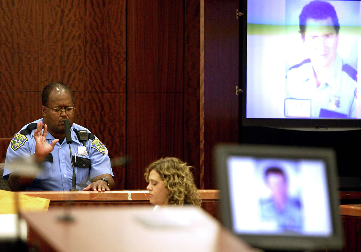 October 10, 2005 Officer Baylous of the Houston Police Department testifies at the trial of Alfred Dewayne Brown who is charged with capital murder in the shooting death of Officer Charles Clark on April 3, 2003. Officer Baylous was an officer on the scene at the time. Officer Roland Baylous of the Houston Police Department on Monday describes at the trial of Alfred Dewayne Brown how police found the slain officer and clerk at a check-cashing shop.