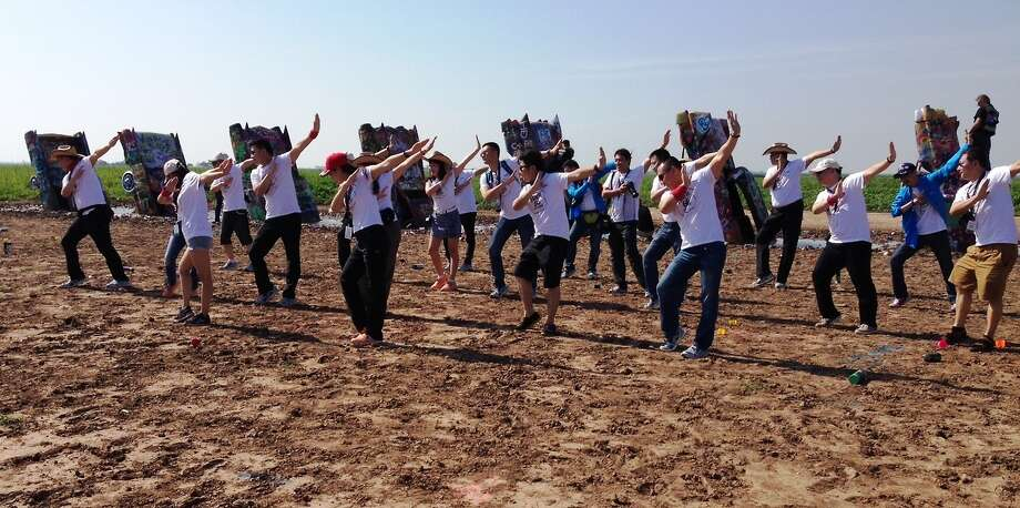 "The group poses for a picture ""Gaga style"" in front of the Cadillac Ranch. Photo: Courtesy/Open Road Productions"