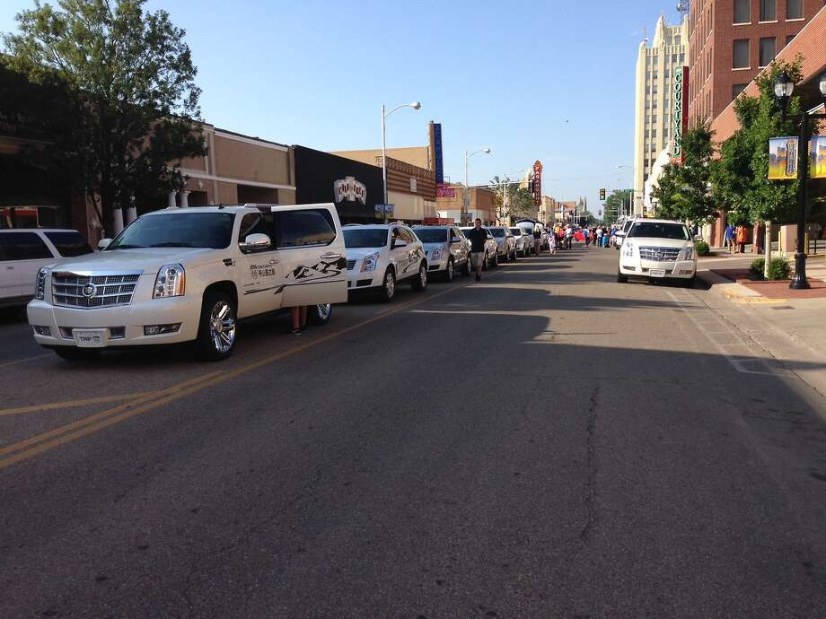 Cadillac owners from China role into Amarillo for an annual Route 66 excursion. The motorcade was escorted by Amarillo police. Photo: Courtesy/Open Road Productions