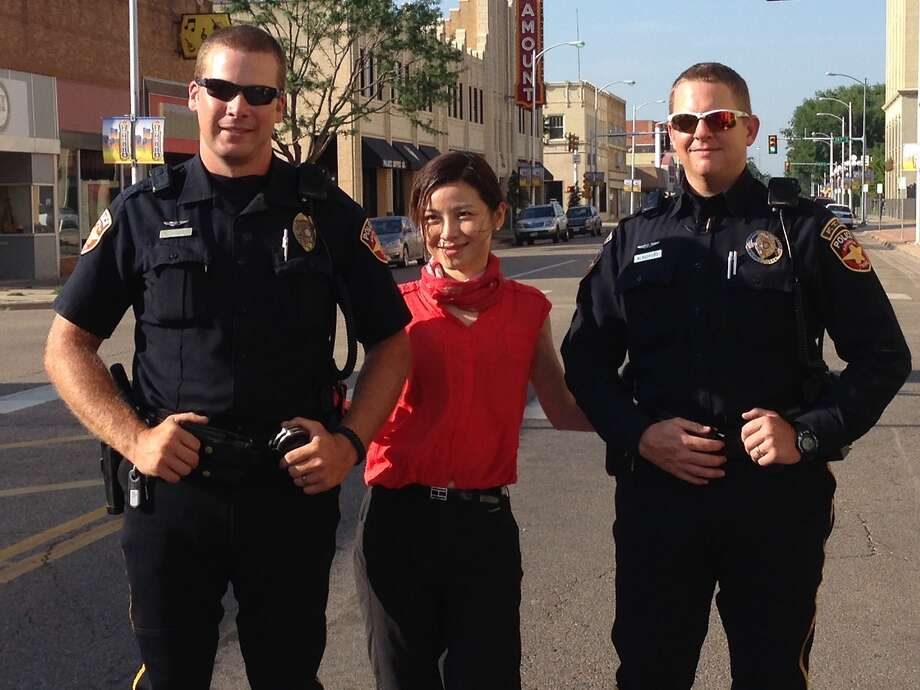 A participant of the Cadillac motorcade poses with Amarillo police officers. Photo: Courtesy/Open Road Productions