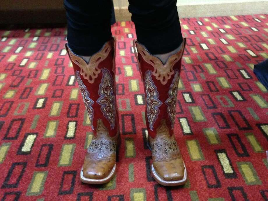 "On Open Road Productions' Facebook, this photo's caption reads, ""Best looking cowboy boots EVAH! They are definitely not for mucking horse stalls or bull riding; these are pure artwork. This Chinese guest will be the most popular cowgirl in China!"" Photo: Courtesy/Open Road Productions"