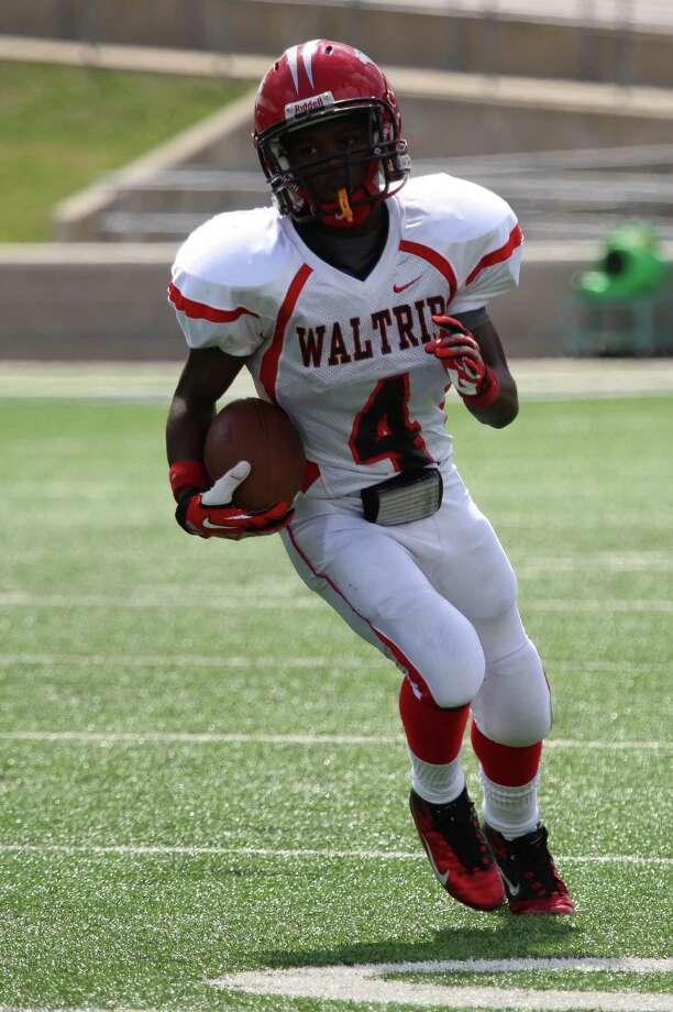 Waltrip running back Malik Jarmon runs the ball for a first down play during the Davis match up Saturday afternoon. Photo: Matthew White, Freelance / Freelance