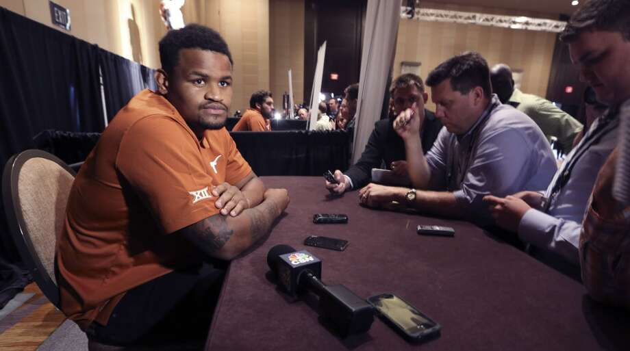 Texas defensive end Cedric Reed listens to reporters questions during the NCAA college Big 12 Conference football media days in Dallas, Tuesday, July 22, 2014. (AP Photo) Photo: Associated Press