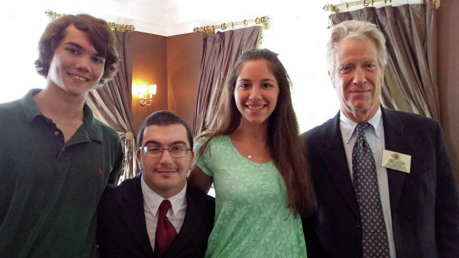 Kiwanis Treasurer Jerry Miller, far right, presents three of the five 2014 Kiwanis Scholarships to Eugene Constandaki, Samuel Kramer and Lauren Perone. Photo: Contributed Photo, Contributed / New Canaan News Contributed