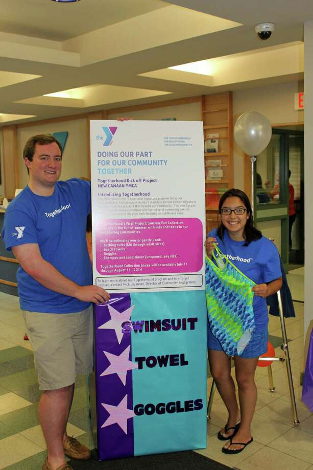 The New Canaan YMCA recently launched Togetherhood, a community service program. Above, committee members Matt Keller and Farah Martin gear up for the program's first event. Photo: Contributed Photo, Contributed / Darien News Contributed