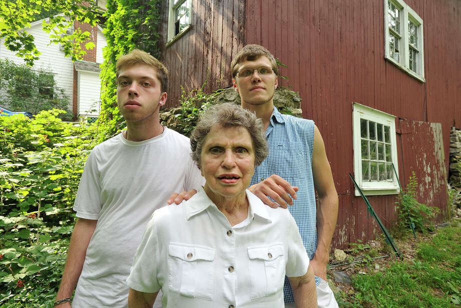 Jordan Pielert, left, and James Pielert pose with their grandmother, Sylvia Knapp, at the Knapp family home in north Stamford, Conn., on Tuesday, July 22, 2014. Janice Pielert, Jordan and James' mother and Sylvia's daughter, died Monday after being struck by a SUV as she was walking across Hoyt Street at Summer Street in downtown Stamford. Janice is the second pedestrian killed by a motorist in the downtown area in the past two months. Photo: Jason Rearick / Stamford Advocate