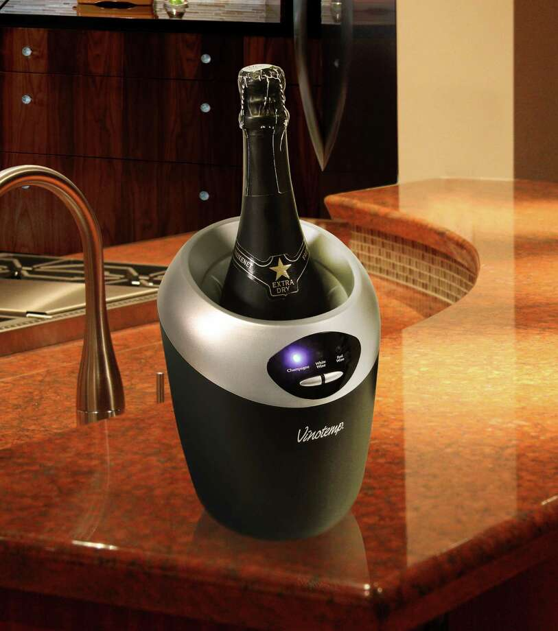 Ice Bucket? What's that you say. I'm sorry, I can't hear you over the sound of me enjoying all this perfectly cooled wine I'm drinking right this very second.Specifically, with the Vinotemp Champagne Chiller, a compactly designed wine cooler perfect for your tabletop. This product uses thermoelectric cooling (no ice required) to easily chill wine to your desired temperature. Comes standard with easy to read LED light display.The Vinotemp Chiller is available here. Photo: Vinotemp