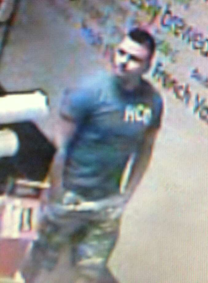 New Canaan police are searching for a suspect in the theft of a wallet at Dunkin' Donuts, 88 Elm St., New Canaan, Conn., July 15, 2014. Surveillance video shows a white or Hispanic man, pictured above, placing the victimís wallet in his pocket after it was left on the counter, police said. Anyone with information pertaining to his identity can contact police at 203-594-3500, the anonymous tip line at 203-594-3544 or by submitting an anonymous tip using the mobile phone app ìMyPDî. Photo: Contributed Photo, Contributed / New Canaan News Contributed