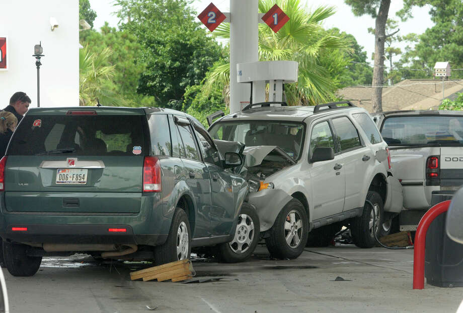 A wayward Saturn ran a red light, swerved into a gas station parking lot at Falvel and Spring Stuebner roads and hit a 78-year-old man pumping gas on Tuesday. Photo: Jerry Baker, For The Chronicle