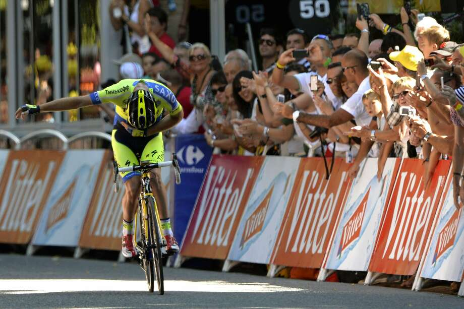 Michael Rogers of Australia takes a bow before crossing the finish line at the end of the 16th stage of the Tour de France. In his 10th tour, Rogers finally won his first stage. Photo: Eric Feferberg, AFP/Getty Images