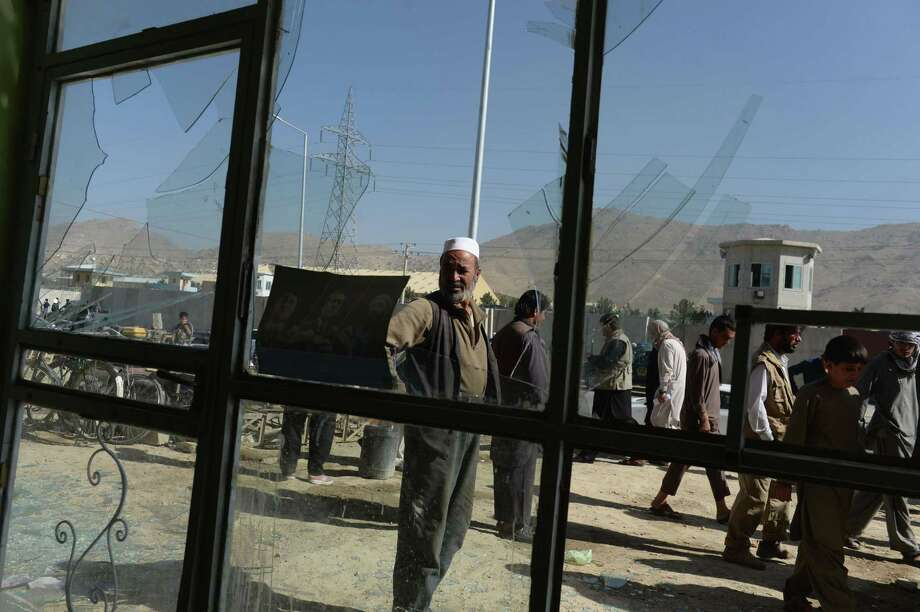 Glass was broken at a shop at the site of a suicide attack in Kabul on Tuesday. A Taliban suicide attacker riding a motorbike killed at least four foreigners in the compound, police said, in the latest blast to rock the capital. Photo: SHAH MARAI, Staff / AFP