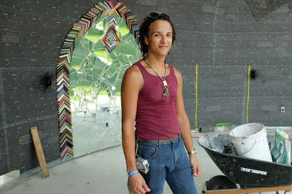 Artist Matt Gifford is covering the amphitheater at Smither Park with a mosaic of found objects. When completed, the structure will resemble the mouth of a large angler fish.