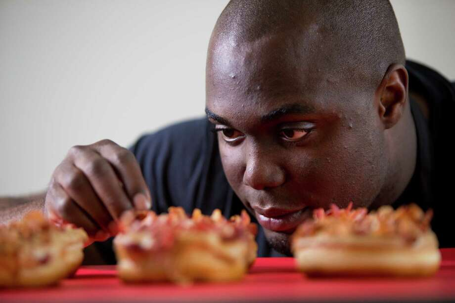 Edose Ohen, 28, is applying his MBA lessons from the Bauer College of Business at the University of Houston to gourmet doughnuts and specialty coffee. Photo: Marie D. De Jesus, Staff / © 2014 Houston Chronicle