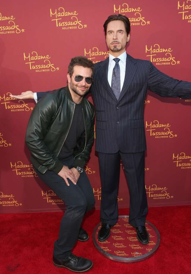 """Actor Bradley Cooper poses alongside a Madame Tussauds Hollywood MARVEL wax figure during the """"Guardians of The Galaxy"""" premiere at the Dolby Theatre on July 21, 2014 in Hollywood, California. Photo: Jesse Grant, Getty Images For Madame Tussauds"""