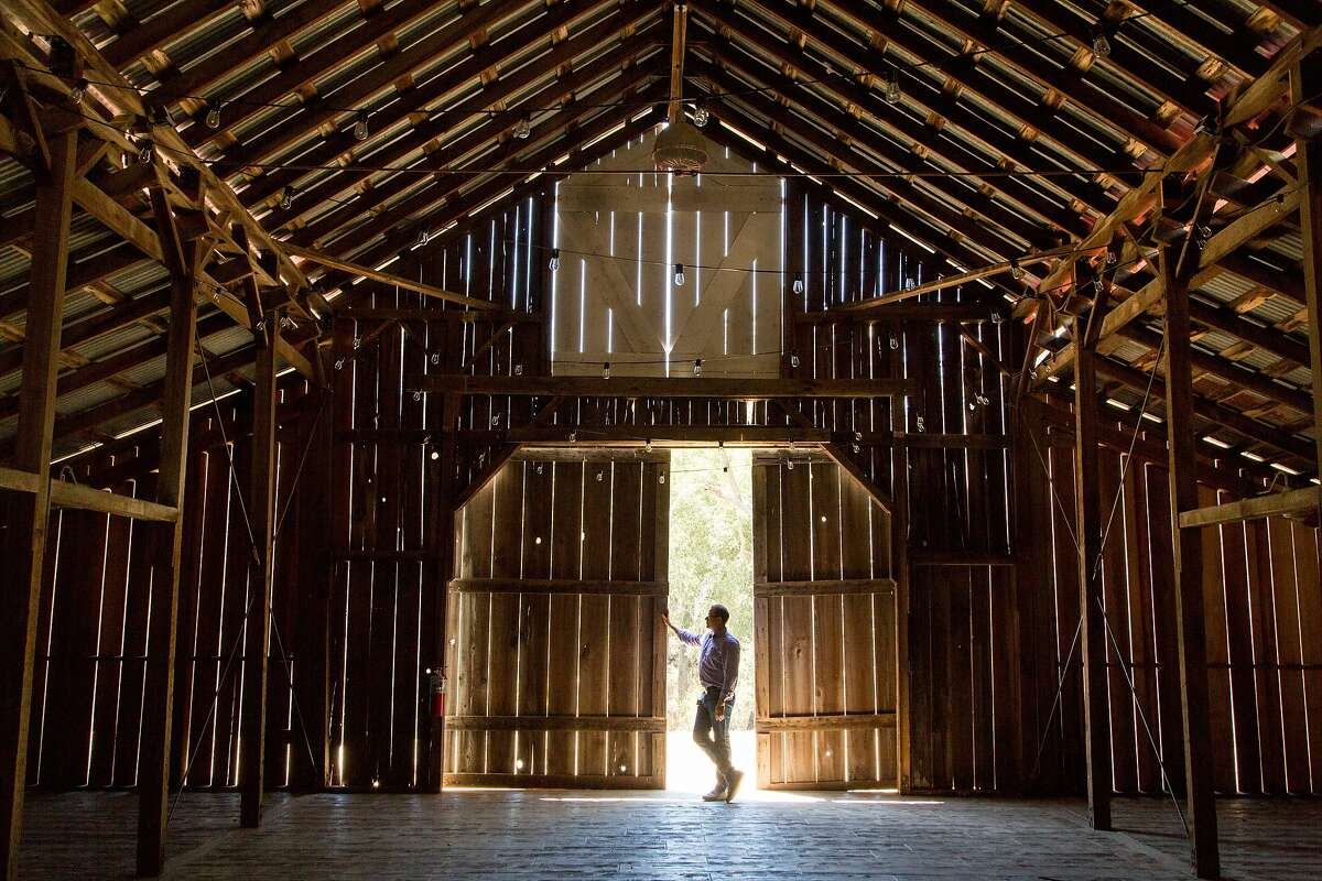 Nicholas May, a tasting room specialist, in the old barn which was restored board by board at the Halter Ranch Vineyard near Paso Robles, Calif., Sunday, July 21, 2014. The historic horse ranch and working farm was purchased in 2000 by Hansjorg Wyss, who has meticulously restored the elaborate 1880s Victorian home, barns and outbuildings as well as building a state-of-the art sustainable winery.