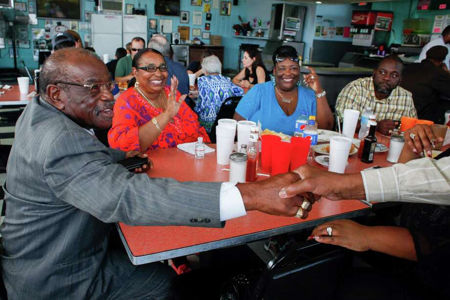 Shirley Edwards, second left, dines with family and friends at Jumbo's, a 24-hour soul food diner in Miami. Jumbo's, the first white-owned restaurant in Miami to employ and serve blacks, is closing after six decades, a victim of urban blight. Photo: ANGEL VALENTIN, STR / NYTNS