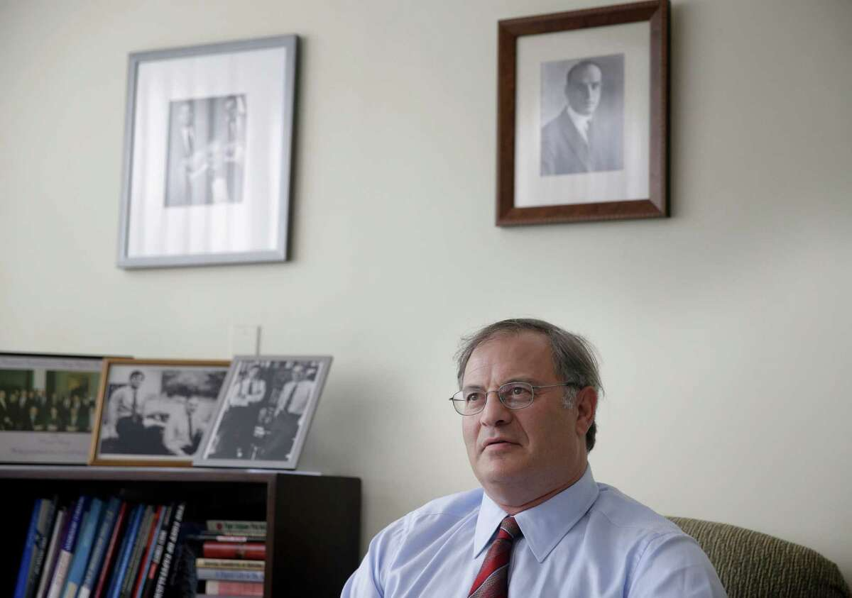 In this July 9, 2014 photo, economist David Levy poses for picture in his office in Mt. Kisco, N.Y. Levy, who oversees the Levy Forecast, a newsletter analyzing the economy that his family started in 1949, says the United States is likely to fall into a recession next year triggered by downturns in other countries, the first time in modern history. (AP Photo/Seth Wenig) ORG XMIT: NYBZ158