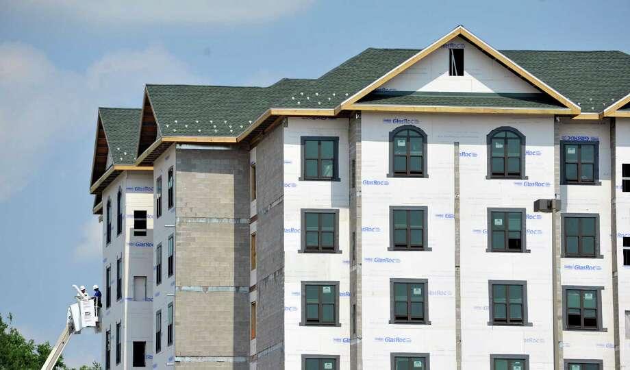 Construction work continues on the Staybridge Suites near Colonie Center Mall, on Tuesday, July 22, 2014, in Colonie, N.Y.  (Paul Buckowski / Times Union) Photo: Paul Buckowski / 00027887A