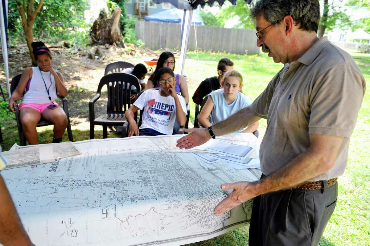 Tony Opalka, the city historian for Albany, points to an old map of the city of Albany as he talks to children in the Young Abolitionist Teen Scholars' Institute at the Stephen & Harriet Myers House, on Tuesday, July 22, 2014, in Albany, N.Y. Opalka was talking about what life was like in the city of Albany back when the Myers were alive. (Paul Buckowski / Times Union)