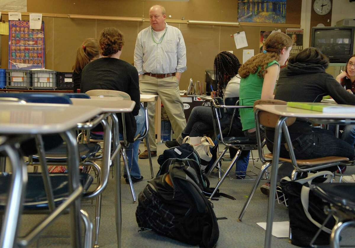 Teacher Tom Healey works with his students in his Theory of Knowledge class at Albany High School on Wednesday, March 17, 2010 in Albany, NY. Healey said that the class pushes the students to explore