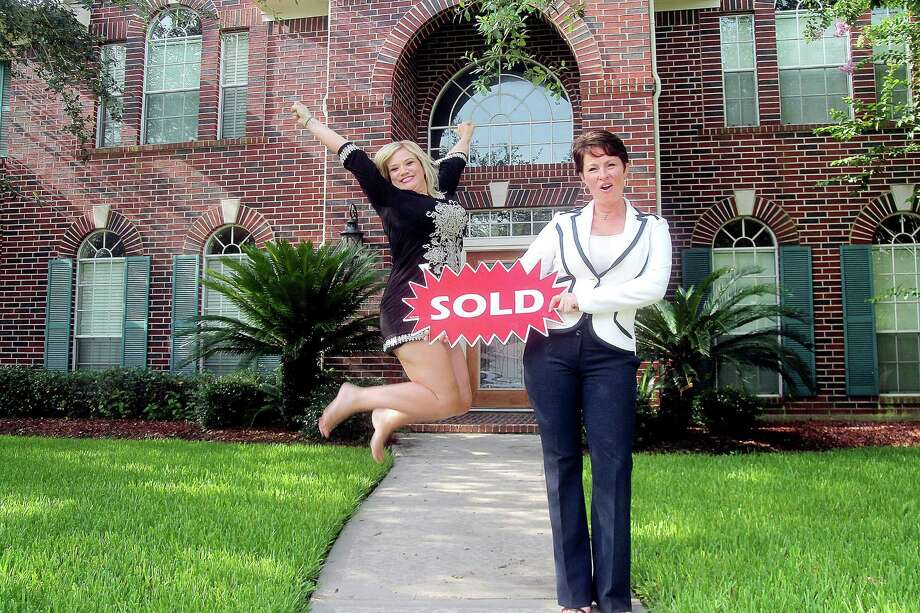 Tanya Hester, left, and Realtor Stephanie Ripple celebrate a successful closing at Hester's Pearland home. Photo: Pin Lim, Freelance / Freelance