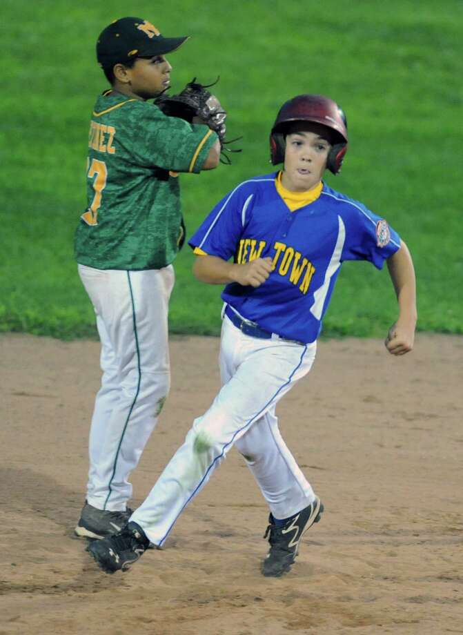 Photos from the Cal Ripken baseball league 11 year old, 70' diamond state tournament game between New Milford and Newtown at Rogers Park in Danbury, Conn. Tuesday, July 22, 2014. Photo: Tyler Sizemore / The News-Times