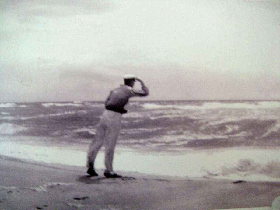 In this 1930s photo provided by the Hendrickson family, Richard Hendrickson leans into the wind as a storm hits a Long Island, N.Y. beach. Hendrickson, who started recording temperatures when Herbert Hoover was in the White House, is being honored as the longest serving volunteer weather data collector for the National Weather Service for his 84 years of collecting information from his farm on eastern Long Island. (AP Photo/Hendrickson Family) Photo: HONS / Hendrickson Family