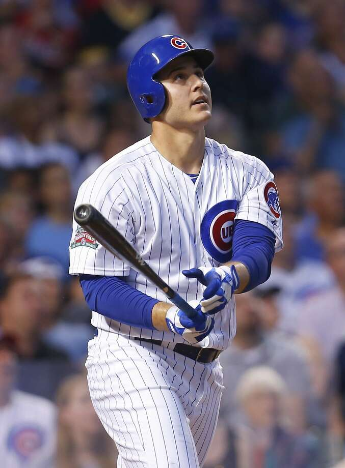 Chicago Cubs first baseman Anthony Rizzo (44) watches his solo home run in the third inning of a baseball game against the San Diego Padres in Chicago, Tuesday, July 22, 2014. (AP Photo/Jeff Haynes) Photo: Jeff Haynes, Associated Press