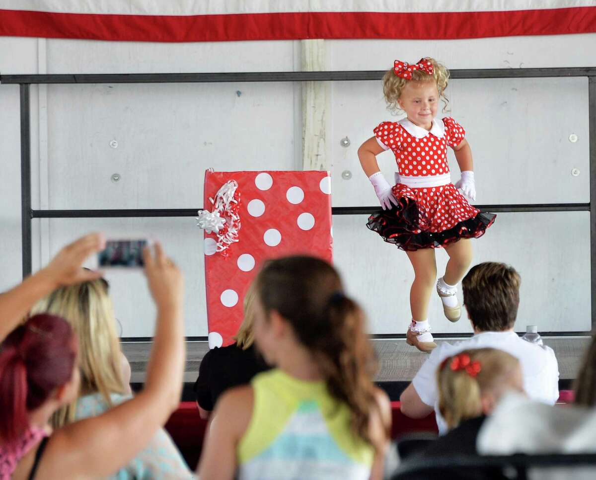 Payton Delaney, 3, of Albany dances during the under 7 talent show on opening day of the Saratoga County Fair Tuesday July 22, 2014, in Ballston Spa, NY. (John Carl D'Annibale / Times Union)