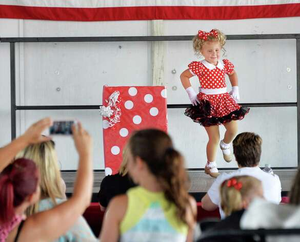 Payton Delaney, 3, of Albany dances during the under 7 talent show on opening day of the Saratoga County Fair Tuesday July 22, 2014, in Ballston Spa, NY.  (John Carl D'Annibale / Times Union) Photo: John Carl D'Annibale / 00027870A