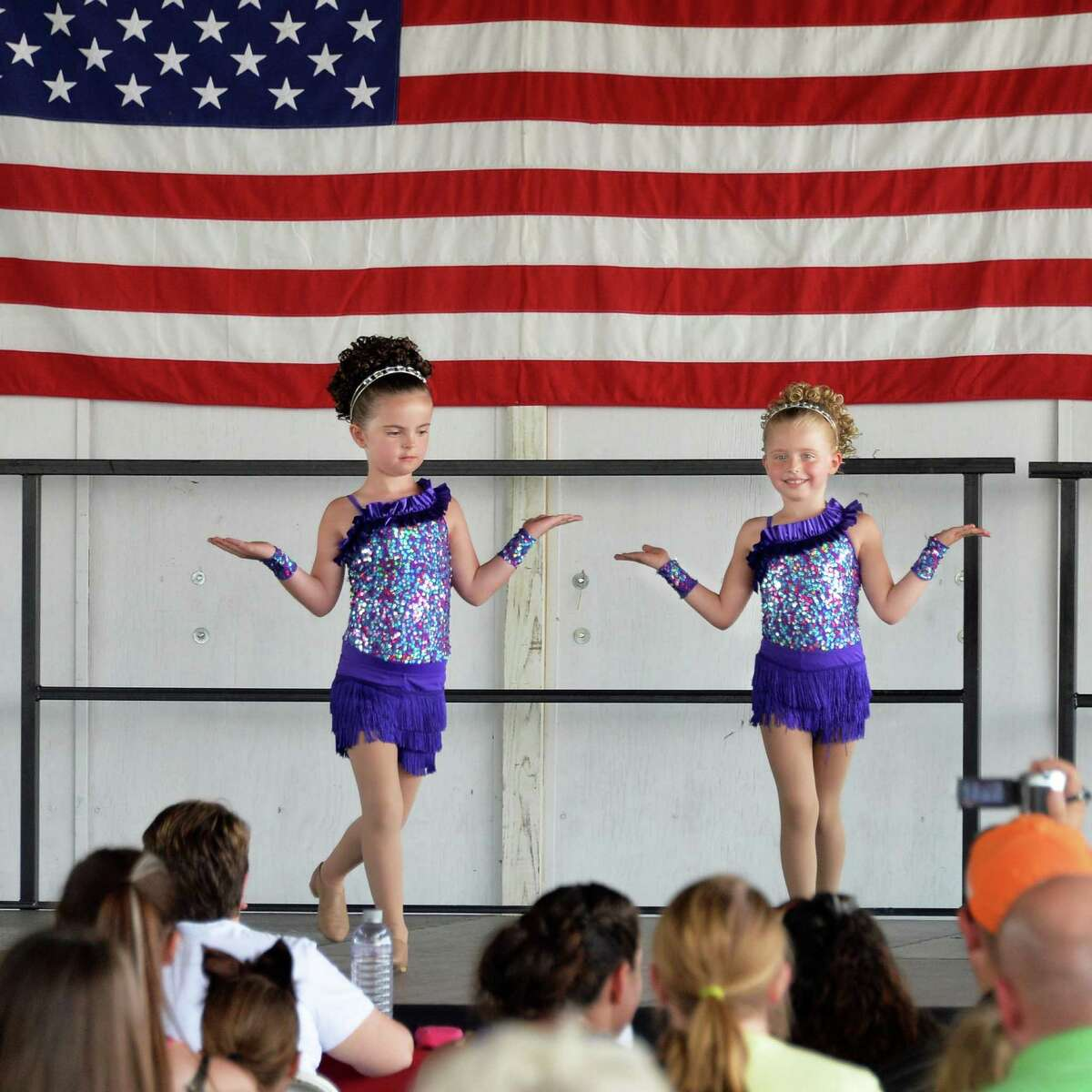 Alyson O'Connor, left, 6, and Emily Hye, 5, of Ballston Spa perform during the under 7 talent show on opening day of the Saratoga County Fair Tuesday July 22, 2014, in Ballston Spa, NY. (John Carl D'Annibale / Times Union)